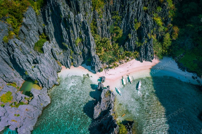 El Nido, Palawan, Philippines. Aerial view of Secret hidden lagoon beach with tourist banca boats on