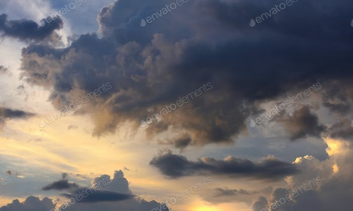 Fantastic view of the dark overcast sky. Picturesque sunset with