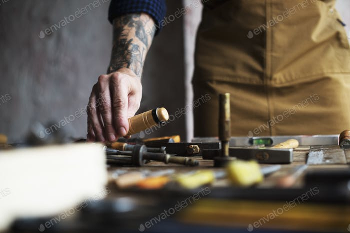 Closeup of carpenter man working with tools equipment set