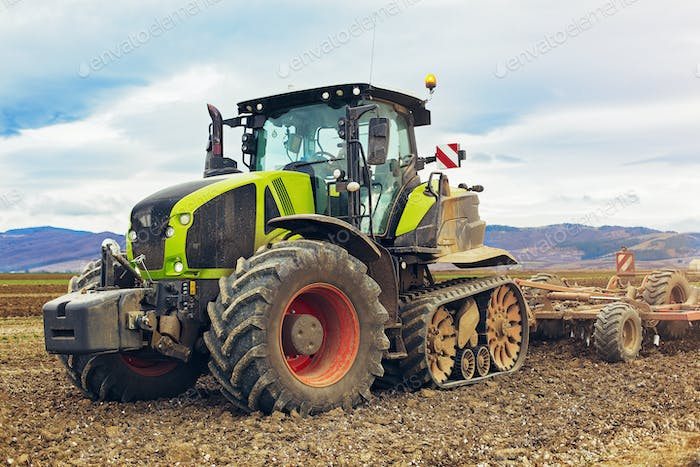 Modern tractor working on the farm, a modern agricultural transport