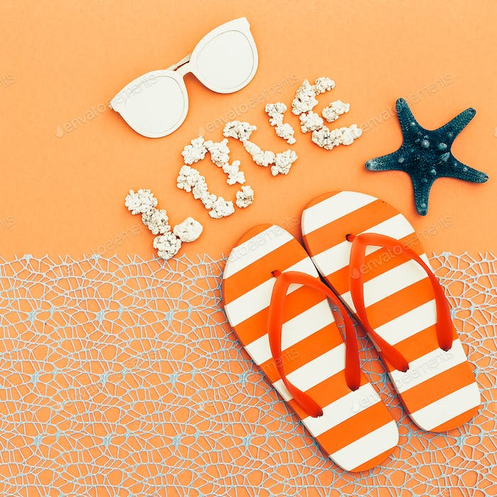 Beach style. Flip-flops, sunglasses. vacation time