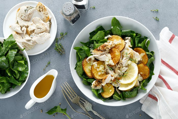 Chicken salad with spinach and crispy potatoes