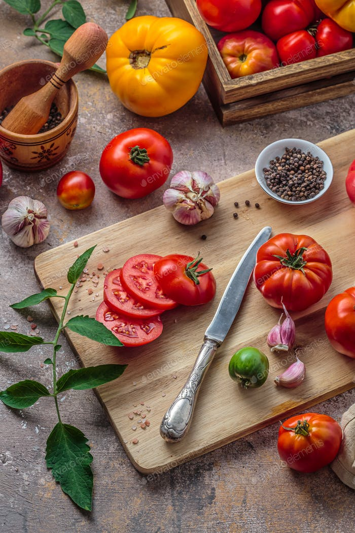 Tomatoes on cutting board with knife