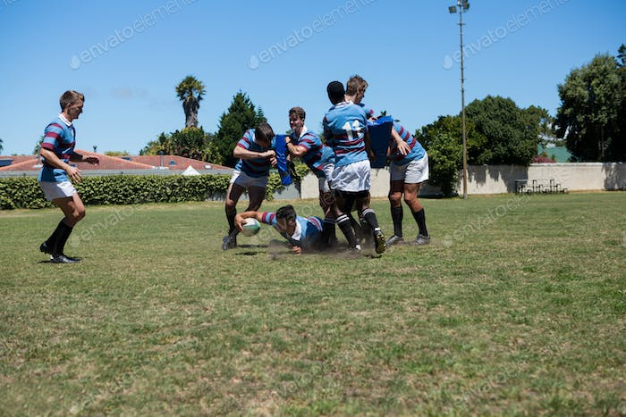 Rugby match at playing field against sky