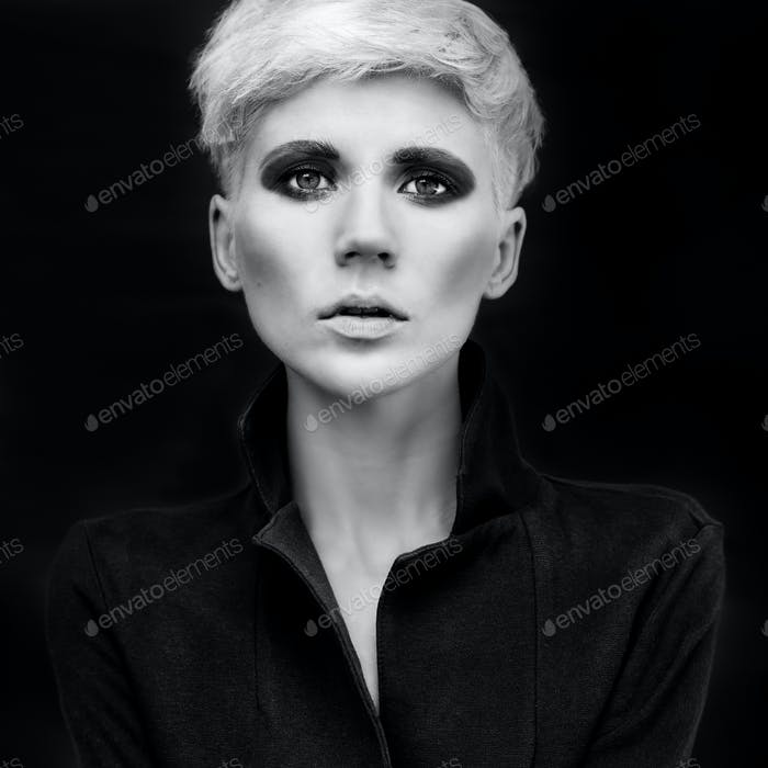 Portrait a sensual girl on a black background