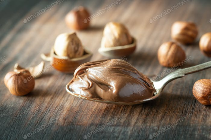 Spoon of chocolate paste with hazelnuts