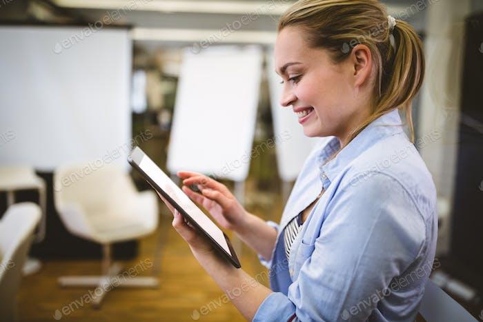 Businesswoman using digital tablet in meeting room