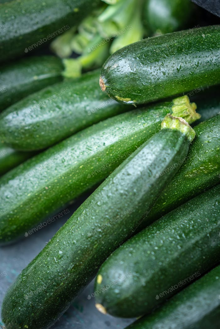 Fresh green organic courgettes on sale