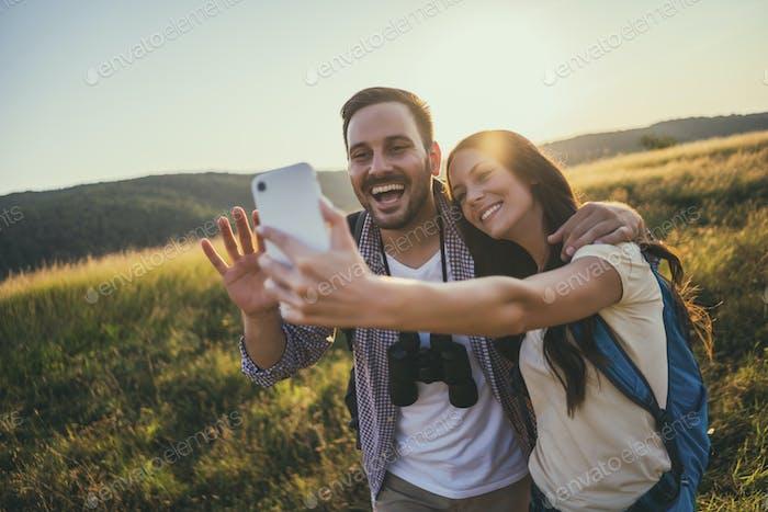 Happy couple is hiking