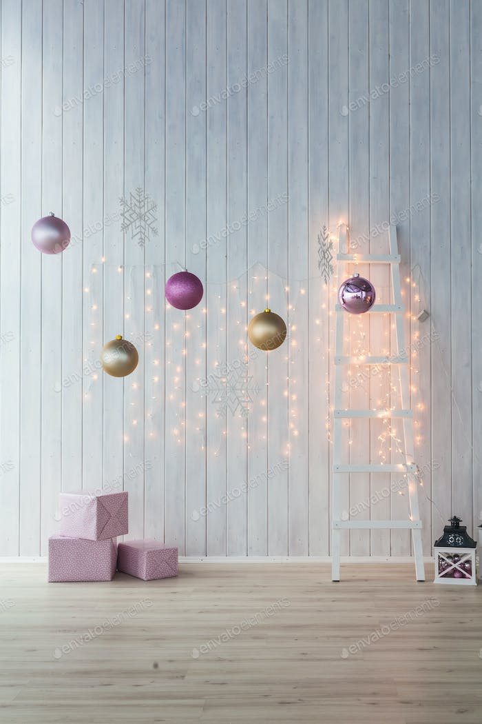 Christmas decoration on white background. Pink gift boxes with golden and  balls