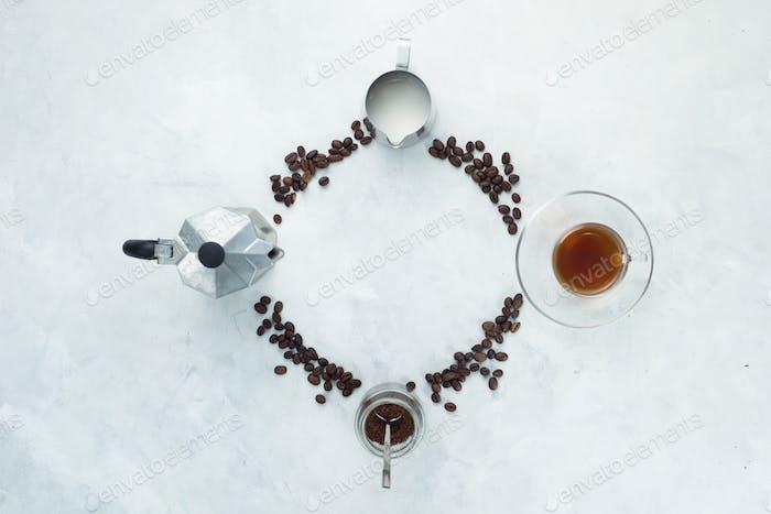 Clock dial with coffee brewing concept. Moka pot, espresso cup, milk jug, ground coffee jar and