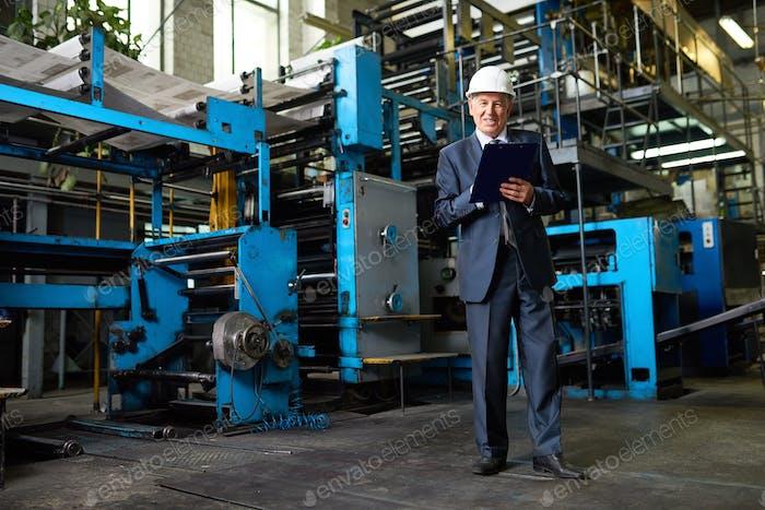 Businessman in Factory Workshop