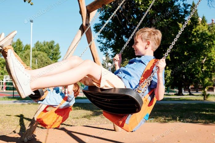 Kids swinging on swings