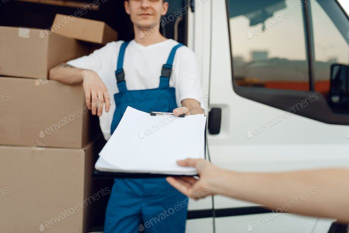 Deliveryman in uniform holding parcel, delivery