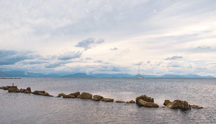 Stones in row in Ionian sea. Greece