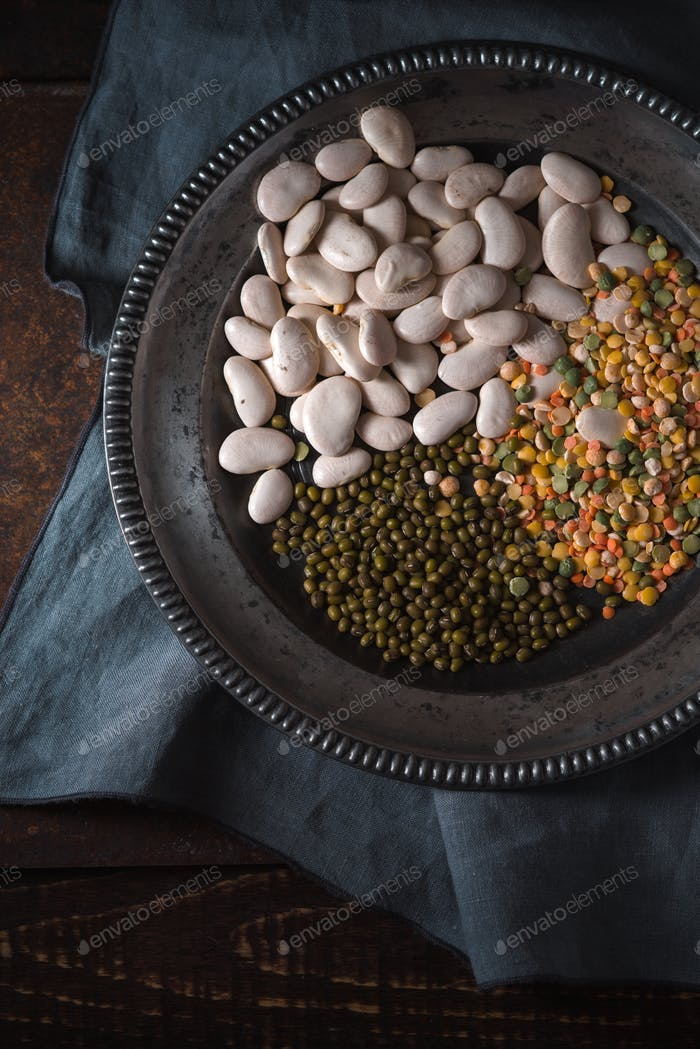 Tin plate with beans on gray napkin