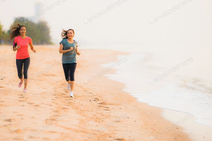 Portrait beautiful young sport asian woman running and exercise