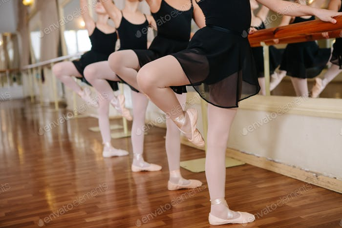 Little ballerinas doing exercises ballet class