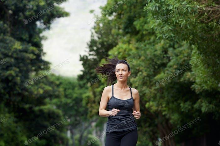 Running woman exercising outdoors