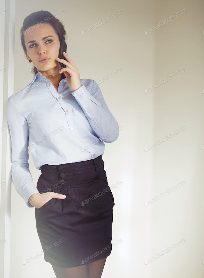 Elegant businesswoman having conversation on her phone