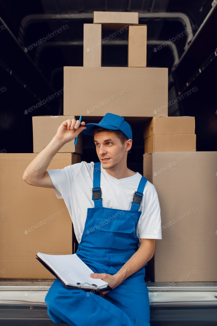 Deliveryman in uniform, parcels in the car, cargo