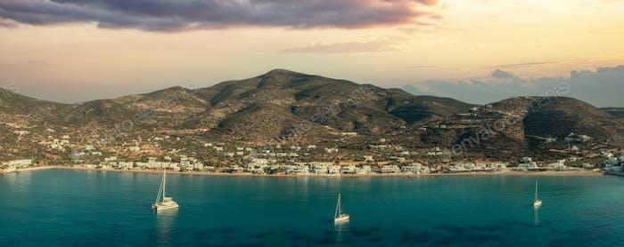 Sifnos island, Platis Gialos village Cyclades Greece. Panoramic view sunset sea sandy beach. Banner