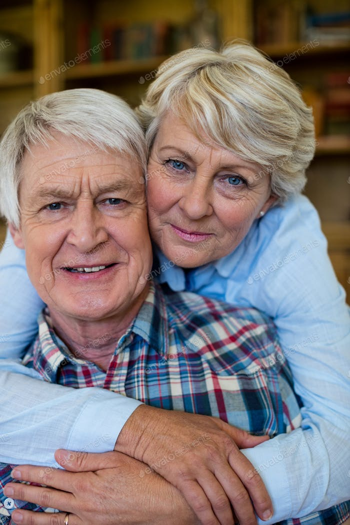 Portrait of senior couple embracing each other
