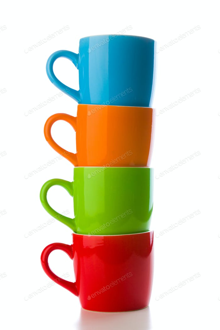pile of colorful ceramic mugs