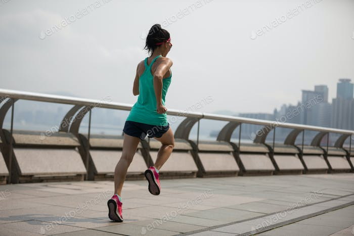 Woman running on Hong kong city
