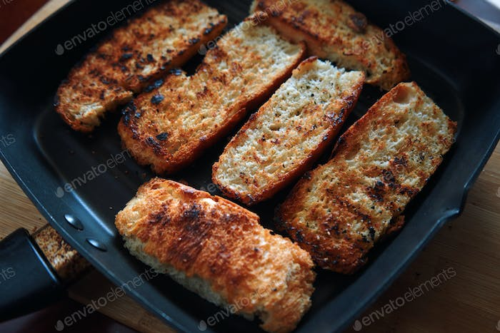 The crispy seared bread in the skillet