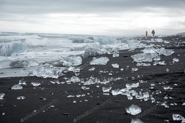 Diamond beach in Iceland on the Atlantic ocean coast. Icebergs from Jokulsarlon glacier lagoon