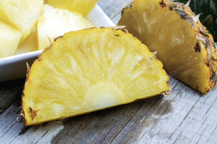 Pineapple slices on wooden
