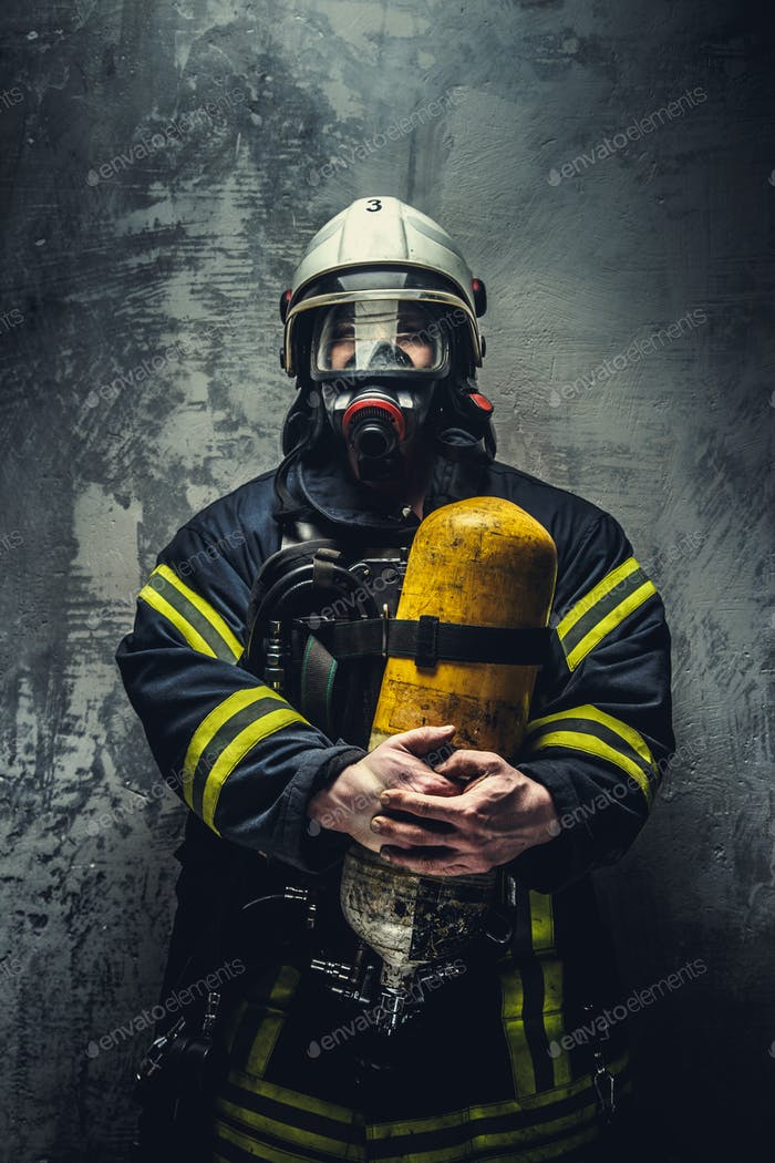Firefighter in oxygen mask.