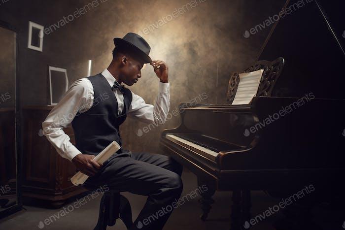 Black grand piano player, jazz musician