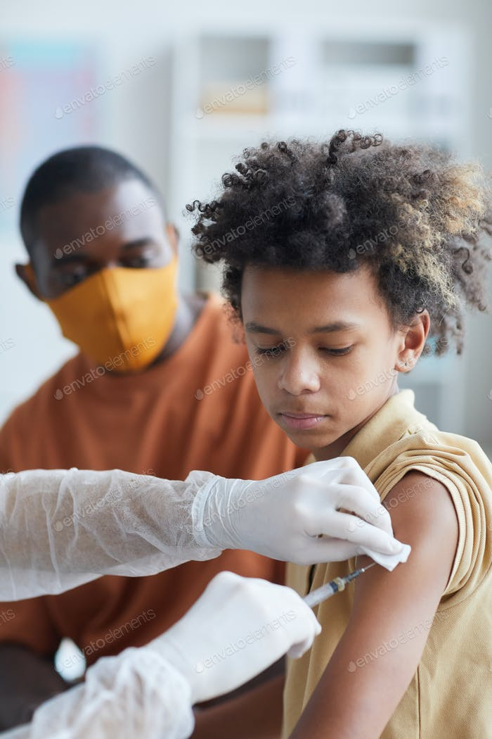 African-American Boy in Vaccination Clinic