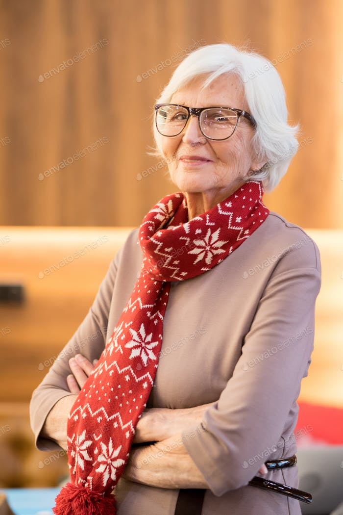 Content wrinkled lady in Christmas scarf