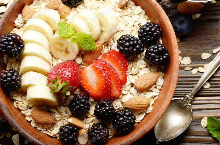 Flat lay top view at Fruit healthy muesli with banana strawberry