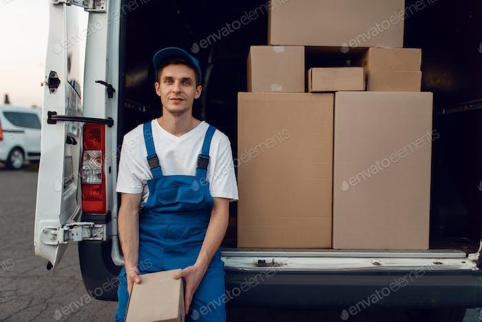 Deliveryman gives parcel to buyer, delivering