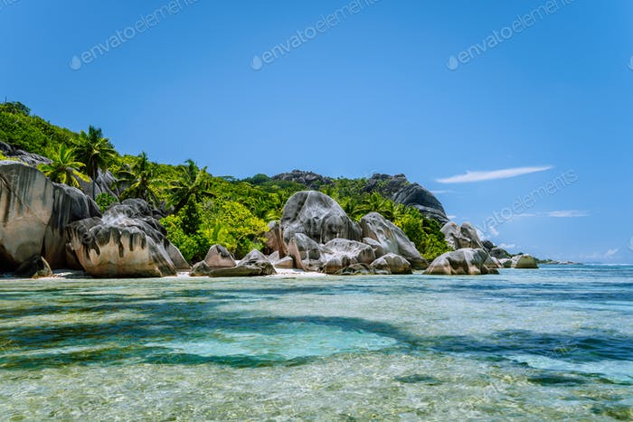 Anse Source d'Argent - Famous granite boulders on paradise tropical beach with shallow turquoise