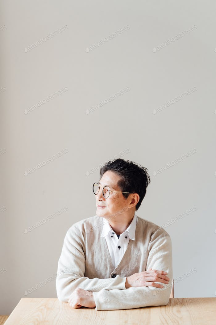 Portrait of senior man sitting at the table