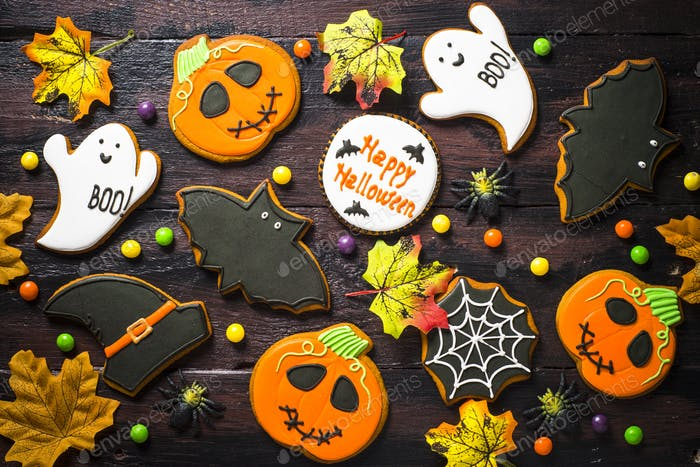 Halloween Gingerbread Cookies - pumpkin, ghosts, bat, on woden table