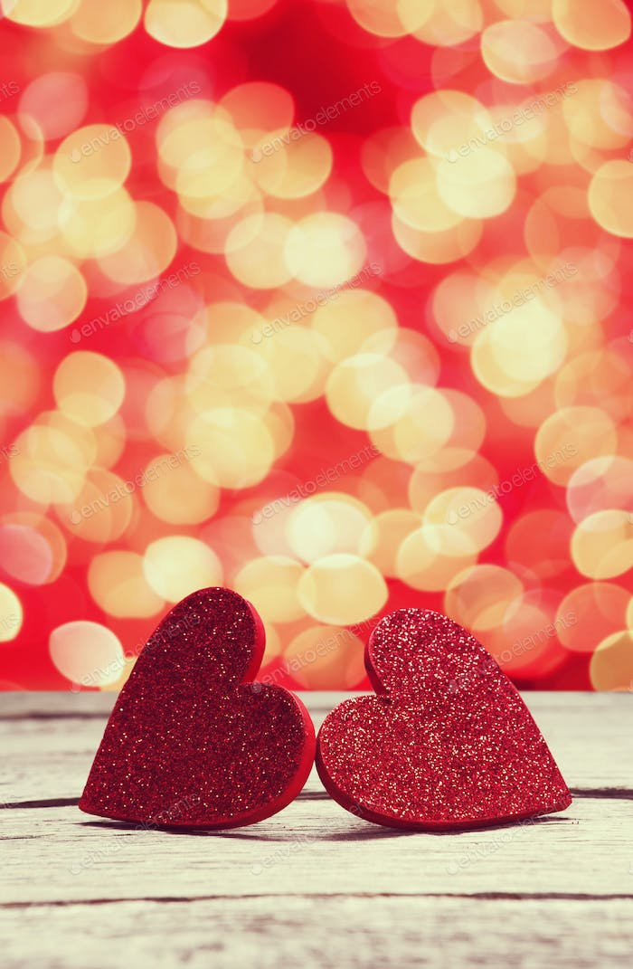 Bokeh background, handmade hearts on wood