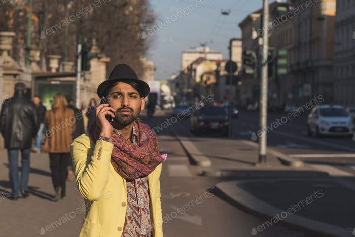 Indian handsome man talking on phone