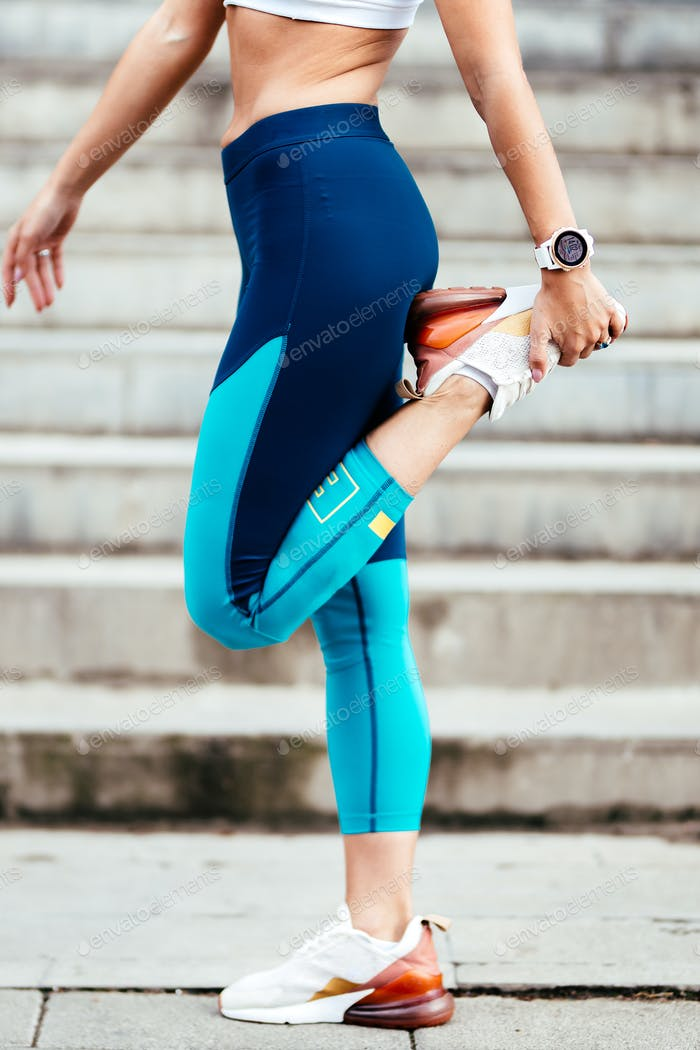Details of stretching exercise. Portrait of athlete running