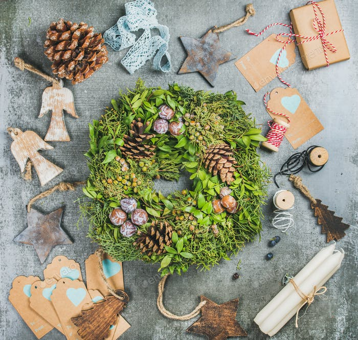 Christmas green wreath, pine cones, wooden toys, candles, decorative materials