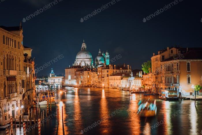 Venice, Italy. Majestic Basilica di Santa Maria della Salute at night. Grand Canal light reflected