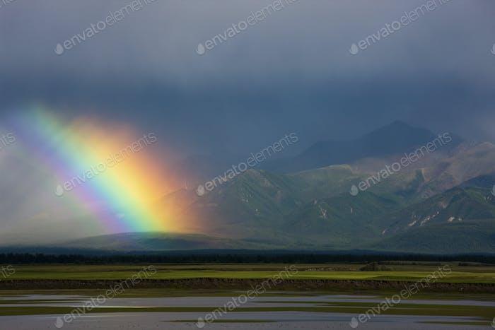 Rainbow over the steppe, Mongolia