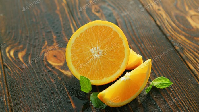 Ripe cut orange on table