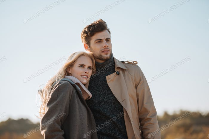 young beautiful couple embracing outdoors