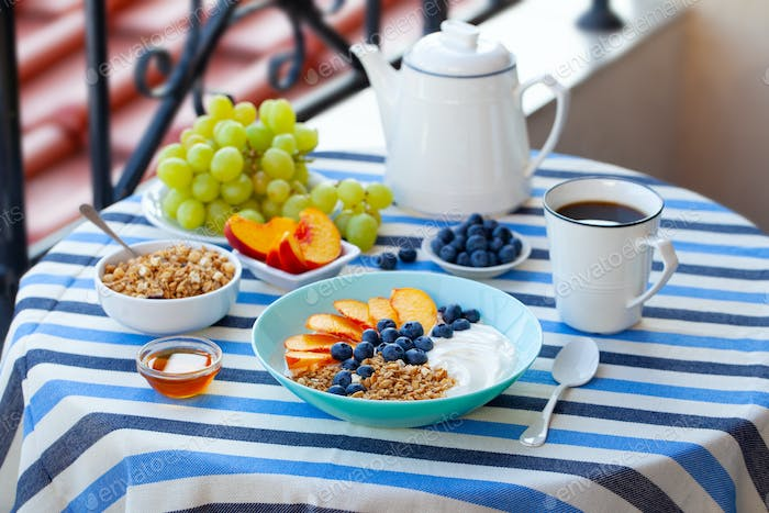 Healthy Breakfast with Coffee Served on Table. Outdoor Background.